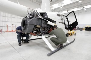 Mechanics Work on R44 Engine