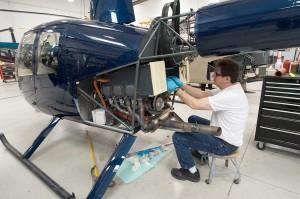 Mechanic Works on R44 Engine