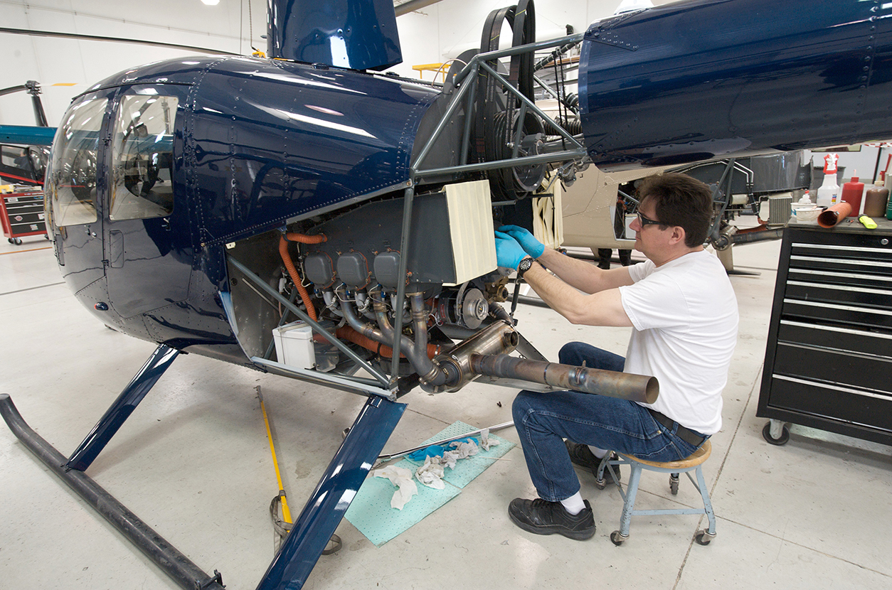 Mechanic Works on R44 Engine