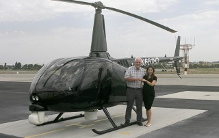 Robinson's Monica Campos delivers R66 Turbine Newscopter to SKY Helicopter's Ken Pyatt