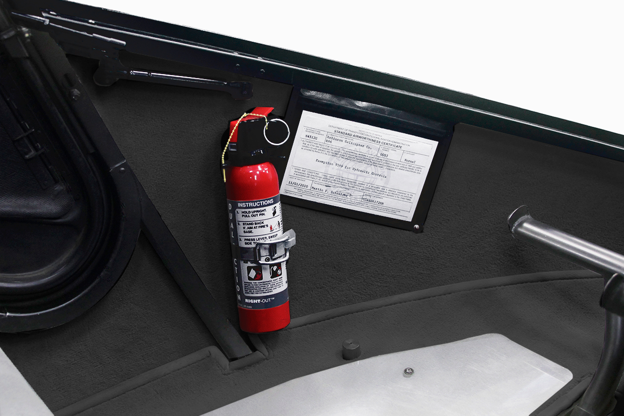 fire extinguisher in bracket on passenger side of helicopter cabin